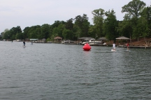 Paddle 4 Purpose racers rounding 1 of 2 buoys